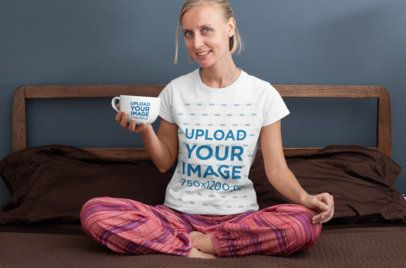 T-Shirt Mockup of a Woman Holding a 24 oz Mug in Her Bedroom 29279