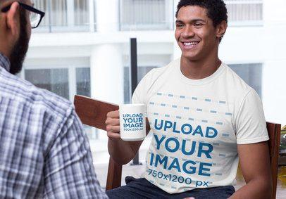 Mockup of a Smiling Man Wearing a Crewneck Tee and Holding a 15 oz Coffee Mug 29258
