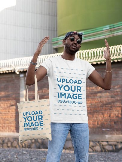 T-Shirt Mockup of a Cool Man Raising His Hands While Carrying a Tote Bag 29438