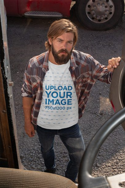 T-Shirt Mockup of a Truck Driver Standing By a Truck's Door 29491
