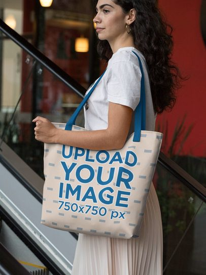 Mockup of a Woman Holding a Tote Bag with Customizable Strap at a Mall 29447
