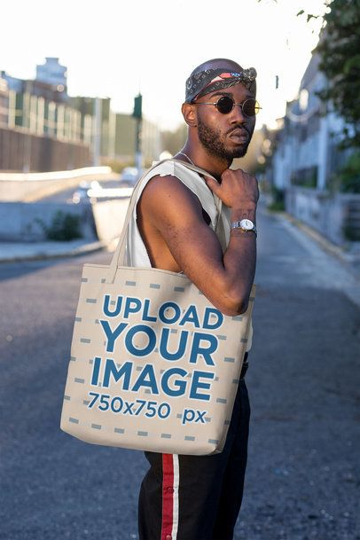 Mockup of a Trendy Man Carrying a Tote Bag with a Customizable Strap 29445