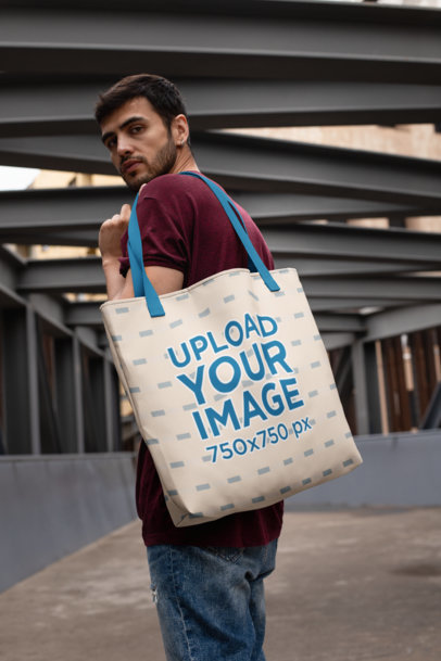 Mockup Featuring a Bearded Man Carrying a Tote Bag with Customizable Straps on His Shoulder 29419