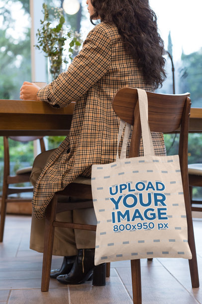 Tote Bag Mockup of a Woman Sitting on a Chair 29457