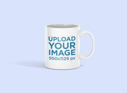 Mockup of an 11 oz Coffee Mug in a Minimalistic Setting 696-el