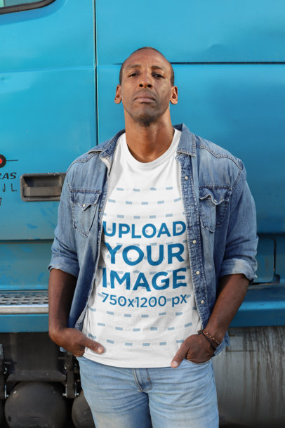 Mockup of a Truck Driver with a Customizable T-Shirt Standing Next to a Truck 29471