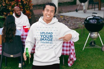 Mockup of a Smiling Man Pointing at His Pullover Hoodie 29716