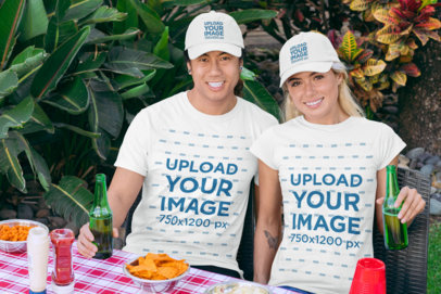 T-Shirt Mockup of Two Friends with Dad Hats at a BBQ Party 29702