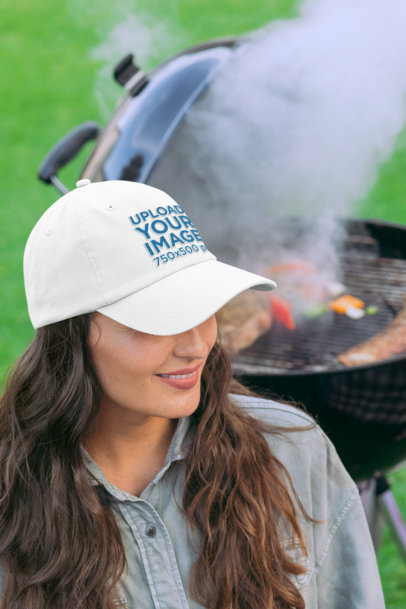 Mockup of a Woman at a BBQ Party Wearing a Dad Hat 29709