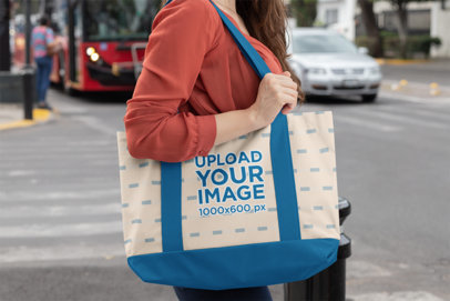 Mockup of a Woman in the Street Carrying a Sublimated Weekend Tote Bag 29793