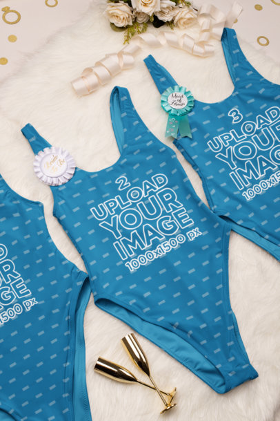 Mockup of Three Swimsuits for a Bachelorette Party Placed Over a Fur Carpet 29569