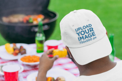 Dad Hat Mockup Featuring a Man at a BBQ Party 29715