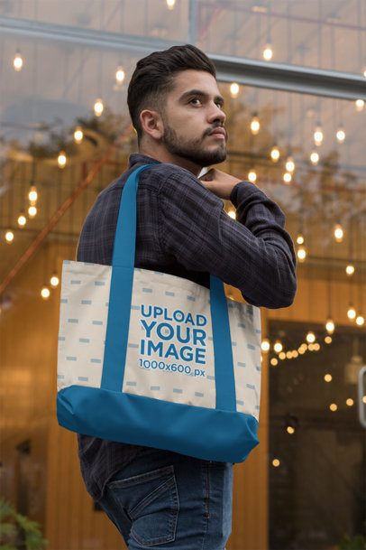 Mockup of a Bearded Man Carrying a Weekend Bag with Customizable Strap  on His Shoulder 29798