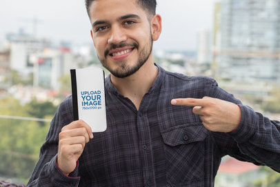 Mockup of a Man Pointing at His Wallet Case for iPhone X 29830