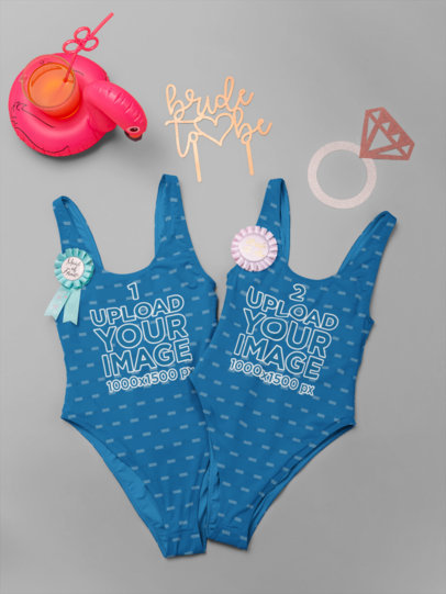 Mockup Featuring Two Bachelorette Swimsuits Lying on a Solid Color Background 29573