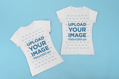 Mockup of Two Matching T-Shirts Placed over a Flat Surface 29638