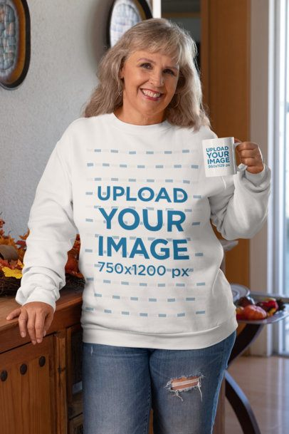 Mockup of an Elderly Woman with a Sweatshirt Holding an 11 oz Coffee Mug 29918