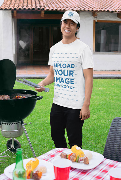 T-Shirt Mockup of a Man with a Dad Hat Grilling at a BBQ Party 29718