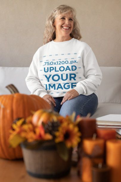 Sweatshirt Mockup of an Elderly Woman at a Thanksgiving-Decorated Living Room 29923