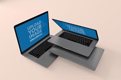 Mockup of Two Piled MacBook Pro Inside a Minimalistic Setting 573-el