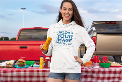 Hoodie Mockup of a Woman Eating Corn at a Tailgate 29906