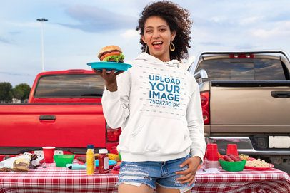 Mockup of a Happy Woman Wearing a Hoodie Pullover at a Tailgate Party 29907