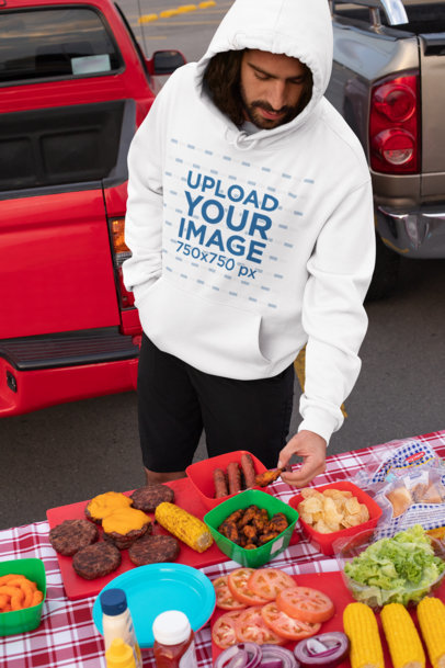 Pullover Hoodie Mockup of a Man Eating at a Tailgate Party 29908