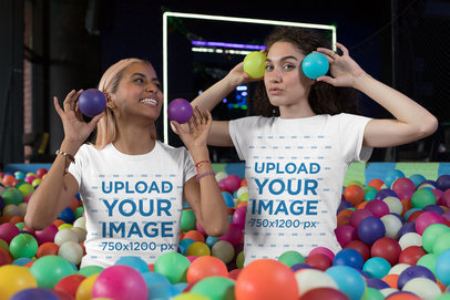 Mockup of Two Friends with Matching Crewneck T-Shirts Playing at a Ball Pit 29630