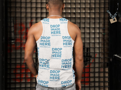 Back Shot of a Black Man Wearing an All-Over Tank Top Mockup Facing a Metal Door a9341b