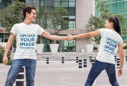 Mockup of a Couple Wearing Matching T-Shirts and Playing Around 29765