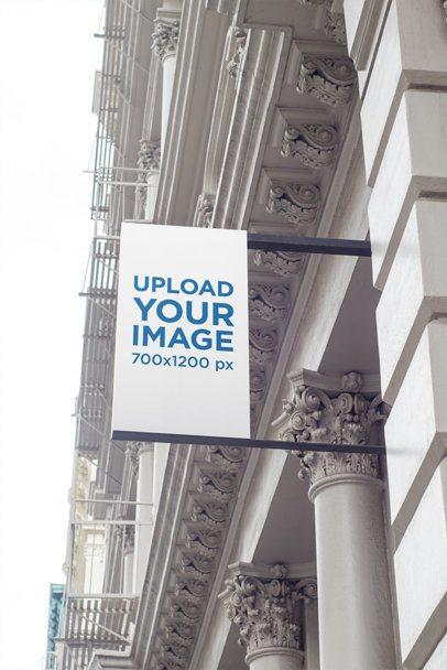 Mockup of a Vertical Shop Sign on an Elegant Building 687-el