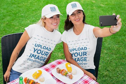 Mockup of Two Female Friends Wearing Customizable T-Shirts and Dad Hats 29710