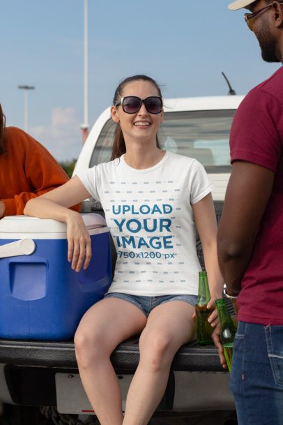 Mockup of a Woman Wearing a Crewneck T-Shirt and Having Fun at a Tailgate 29885