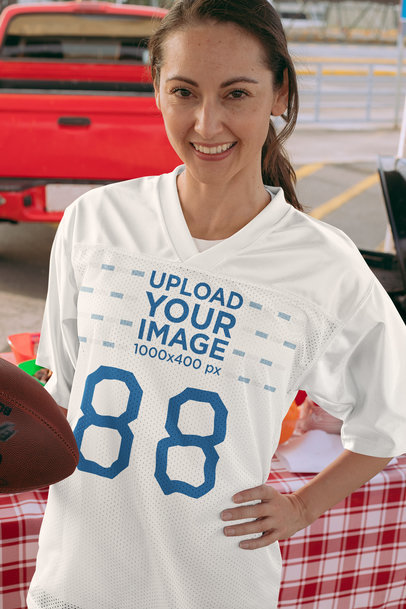 Mockup of a Woman with an Oversized Jersey at a Tailgate Party 29902