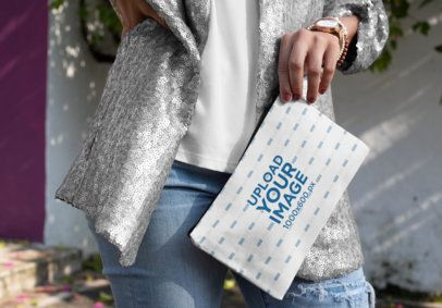 Mockup of a Trendy Woman Holding Her Pouch 29967