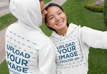 Front and Back Mockup of an Affectionate Couple Wearing Customizable Hoodies 29774