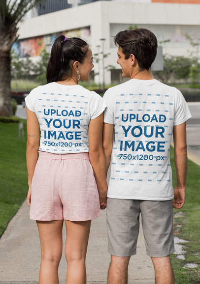 Back View Mockup of a Couple Wearing Crewneck T-Shirts on the Street 30087