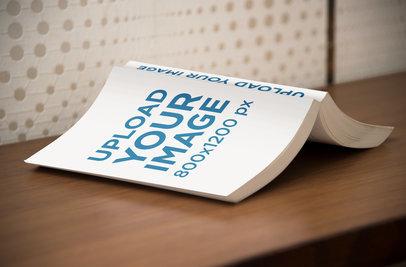 Mockup of an Open Digest Size Book Lying Facedown on a Desk 869-el