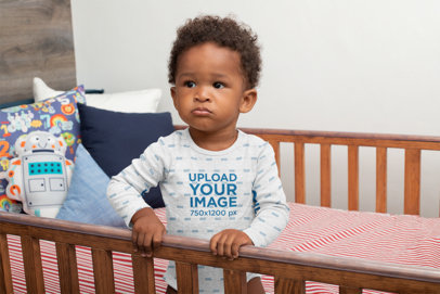Heathered Onesie Mockup of a Baby Boy in His Crib 30025
