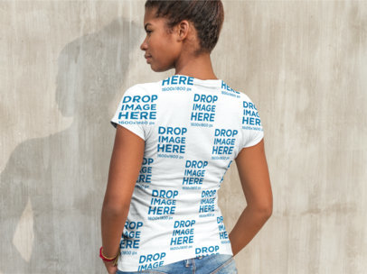 Back Shot of a Black Girl Wearing a Sublimated Tee Facing a Concrete Wall a9646b