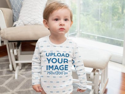 Heather Mockup of a Little Boy Wearing a Long Sleeve Onesie in a Living Room 30003