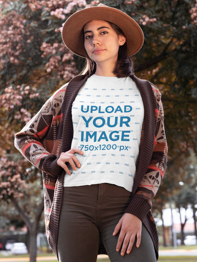 T-Shirt Mockup of a Stylish Woman with Trees in the Background 30110