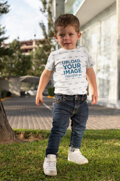 Short-Sleeve Heather Onesie Mockup Featuring a Boy Posing in the Backyard 29913