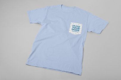 Pocket Tee Mockup Lying Flat Against a Solid Surface 30086