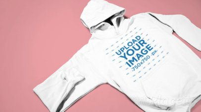 Video of a Pullover Hoodie over a Solid Background 30251