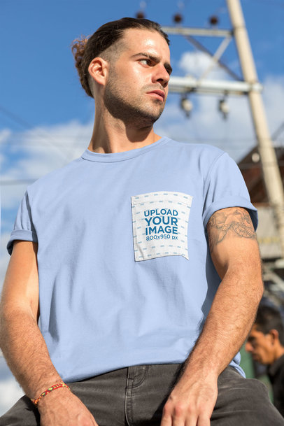 T-Shirt Pocket Mockup Featuring a Serious-Looking Man with a Tattoo 30051