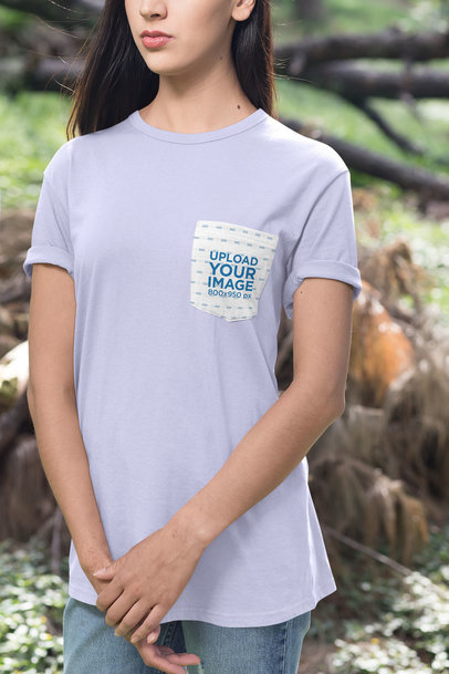 Mockup of a Woman Standing in an Open Area Wearing a Pocket Tee 30077