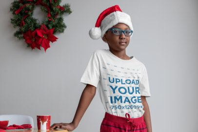 T-Shirt Mockup of a Cool Kid Wearing a Christmas Hat 30343