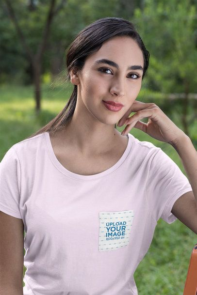Pocket Tee Mockup of a Young Woman at a Park 30073