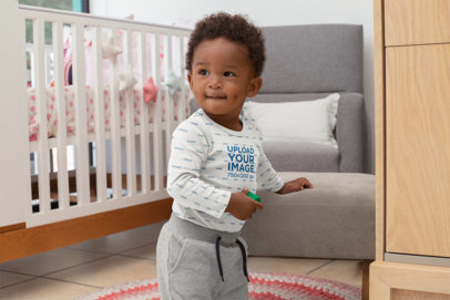 Mockup of a Boy in a Long Sleeve Onesie Playing in His Bedroom 30031